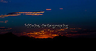 """Captured during late August 2010, traveling West on Interstate 10.  The Arizona sunset creates the look of a volcano's crater of molten lava.  20"""" x 10"""".  Printed on Parrot Digigraphic Photo Gloss Paper.  LImited Edition of 25."""