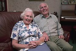Older couple sitting on the sofa,