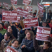 Nez/Lizer voters listen and cheer as the results come in from the radio during the Navajo Nation Presidential election on Tuesday in Window Rock.