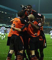 Credit: Back Page Images / Matthew Impey. Queens Park Rangers v Ipswich Town, The Championship, 11/12/2004. Fabian Wilnis leaps on top of the celebrating Ipswich players after Darren Currie had put them into a 3-2 lead.