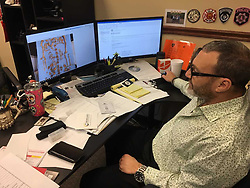 November 21, 2018 - IL, USA - Lake County Coroner Dr. Howard Cooper at his desk with a picture of the Native American bones found near the Chain O'Lakes. ''This was fascinating,'' he said of the bones, thought to be 800 to 1,000 years old. (Credit Image: © Frank Abderholden/Chicago Tribune/TNS via ZUMA Wire)