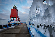 An ice-covered railing leads to Charlevoix South pier Light