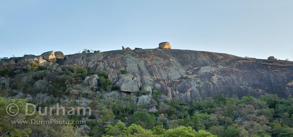 A long steep granite escarpment in Matobo National Park, part of the Motopos Hiils area in Zimbabwe. The park is an U.N. UNESCO World Hertiage Site. © Michael Durham / www.DurmPhoto.com