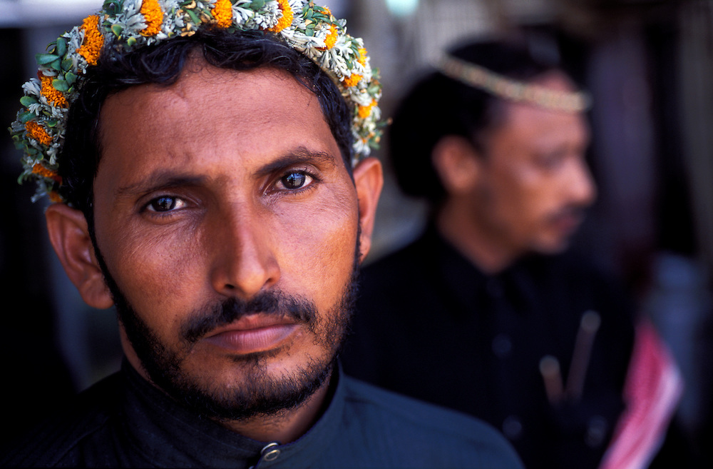 """The Qahtani tribe of the Arabian peninsula are said to be the oldest. They wear flowers,herbs and grasses in their hair. Abha, Asir region. They are known as the """"Flower Men""""."""