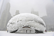 """The sculpture """"Cloud Gate"""", commonly known as """"the bean"""" is covered in snow on March 5, 2013 in Chicago, Illinois. The worst winter storm of the season is expected to dump 7-10 inches of snow on the Chicago area with the worst expected for the evening commute.  (Getty Images)"""