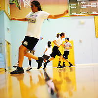 111412  Adron Gardner<br /> <br /> Lady Scouts sprint to the sideline between basketball practice shooting drills at Window Rock High School in Fort Defiance Wednesday.
