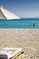 Person swimming in tropical turquoise waters of White Sand Beach, Boracay, Philippines.