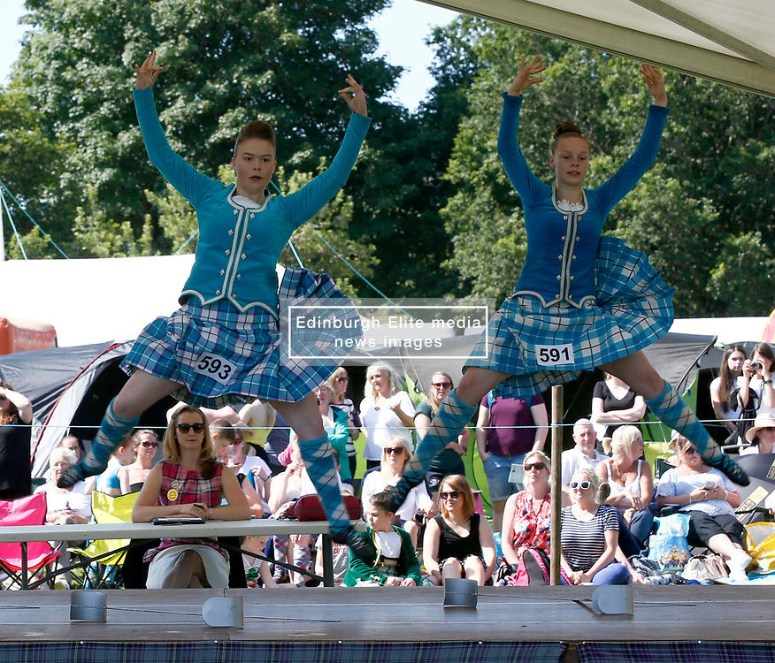 Inveraray Highland Games held in the grounds of Inveraray Castle feature many competitions including piping, highland dancing, field events as well as the usual heavy events.Highland dancers Iona-Maree Scott (L) and Catriona Gammon (R) compete in the dancing event..... (c) Stephen Lawson   Edinburgh Elite media