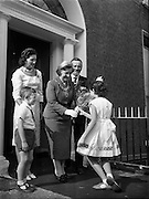 24/09/1958<br /> 09/24/1958<br /> 24 September 1958<br /> Opening of Le Pompadour Salon by the Lord Mayor of Dublin Catherine Byrne, for Mr. Victor Vinmar at 6 Upper Fitzwilliam Street, Dublin. Image show the Lord Mayor being greeted outside the premises.