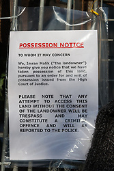 London, UK. 26th February, 2019. A Possession Notice posted by bailiffs from the National Eviction Team outside Grow Heathrow, a squatted eco-community founded in 2010 on a previously derelict site close to Heathrow airport in protest against government plans for a third runway. The community has since developed an extensive garden and is acknowledged to have made a significant educational and spiritual contribution to life in the Heathrow villages which are threatened by airport expansion. Bailiffs have almost secured the front section of the site, owned by Imran Malik, removing several protesters locked on in towers above the camp, but four protesters are believed to remain in a tunnel beneath that area. Many more protesters remain on the rear portion of the site. Five legal challenges to the government's approval of a 3rd runway at Heathrow will proceed to judicial review at the Royal Courts of Justice on 10th March.