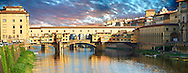 """Panoramic view of the medieval The Ponte Vecchio (""""Old Bridge"""") crossing the River Arno in the hiostoric centre of Florence, Italy, UNESCO World Heritage Site. .<br /> <br /> Visit our ITALY PHOTO COLLECTION for more   photos of Italy to download or buy as prints https://funkystock.photoshelter.com/gallery-collection/2b-Pictures-Images-of-Italy-Photos-of-Italian-Historic-Landmark-Sites/C0000qxA2zGFjd_k<br /> .<br /> <br /> Visit our MEDIEVAL PHOTO COLLECTIONS for more   photos  to download or buy as prints https://funkystock.photoshelter.com/gallery-collection/Medieval-Middle-Ages-Historic-Places-Arcaeological-Sites-Pictures-Images-of/C0000B5ZA54_WD0s"""