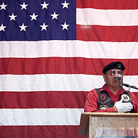 Tooley Brown from Veterans Helping Veterans leads the Pledge of Allegiance at the Martin Luther King day program at the Larry Brian Mitchell Recreation Center Monday in Gallup.