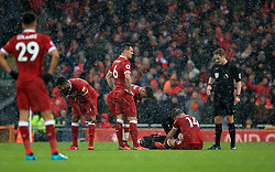 Liverpool's Jordan Henderson receives treatment during the Premier League match at Anfield, Liverpool.