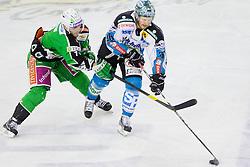 Domen Vedlin (HDD Tilia Olimpija, #7) vs Rob Hisey (EHC Liwest Linz, #26) during ice-hockey match between HDD Tilia Olimpija and EHC Liwest Black Wings Linz at fourth match in Semifinal  of EBEL league, on March 13, 2012 at Hala Tivoli, Ljubljana, Slovenia. (Photo By Matic Klansek Velej / Sportida)