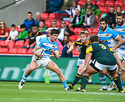 Argentina's Bautista Delguy  sides steps South Africa prop Johan Sadie  during the World Rugby U20 Championship 3rd Place play-off  match Argentina U20 -V- South Africa U20 at The AJ Bell Stadium, Salford, Greater Manchester, England on Saturday, June 25, 2016.(Steve Flynn/Image of Sport)