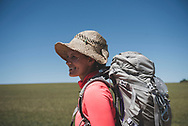 Erna, from the United States, smiles with just a couple kilometers to go before reaching the destination for the day: Carrion de Los Condes. (June 17, 2018)<br />