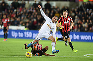 Leon Britton of Swansea city ©  is fouled by Karl Henry  of QPR Barclays Premier league match, Swansea city v Queens Park Rangers at the Liberty stadium in Swansea, South Wales on Tuesday 2nd December 2014<br /> pic by Andrew Orchard, Andrew Orchard sports photography.