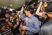 27 MAY 2014 - BANGKOK, THAILAND: CHATURON CHAISANG turns to wave to reporters and supporters after he was arrested by Thai Army soldiers at the Foreign Correspondents' Club of Thailand during a press conference. Chaturon, a former Deputy Prime Minister and Education Minister and a senior member of the Pheu Thai Party (the party of the elected civilian government) was arrested by military authorities in Bangkok while he was talking to reporters at the Foreign Correspondents' Club of Thailand. A squad of soldiers came into the packed FCCT dining room, confronted Chaturon and led him to a waiting van.     PHOTO BY JACK KURTZ