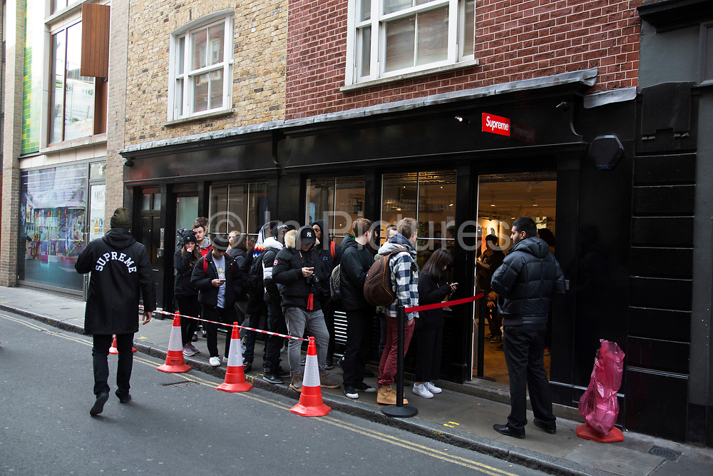 Every Thursday the fashion label Supreme, which is a skateboarding shop / clothing brand releases new lines and so fans of the brand queue outside this shop in Soho to be first in line for some original fashions in London, England, United Kingdom.