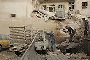 Nov. 18, 2015 - Aleppo, Syria - <br /> <br /> Syria Confict<br /> <br /> Syrians search for survivors amidst the rubble of a house after a reported missile fired by Syrian government forces hit a residential area in the Al-kalashh district in the northern Syrian city of Aleppo on November 18, 2015. <br /> ©Exclusivepix Media