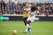 Bafetimbi Gomis of Swansea city holds off Nacho Monreal of Arsenal. Barclays Premier league match, Swansea city v Arsenal  at the Liberty Stadium in Swansea, South Wales  on Saturday 31st October 2015.<br /> pic by  Andrew Orchard, Andrew Orchard sports photography.