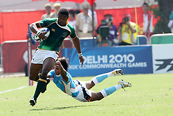 Sibusisio Sithole evades the tackle and heads for the try line during the XIX Commonwealth Games 7s rugby match between South Africa and India held at The Delhi University in New Delhi, India on the  11 October 2010..Photo by:  Ron Gaunt/photosport.co.nz