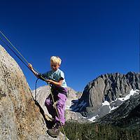 ROCK CLIMBING. Nick Wiltsie (MR) on his first rappel, Big Pine Cyn. (Sierra)J.Muir Wilderness,CA