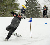 Ryan McGarghan makes a great effort to catch Jason Baldini's toss during Tavern 27's Showshoe Disc Golf Tourney Saturday afternoon on their Mystic Meadows course.  (Karen Bobotas/for the Laconia Daily Sun)