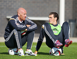 NEWPORT, WALES - Tuesday, October 7, 2014: Wales' James Collins and Gareth Bale during training at Dragon Park National Football Development Centre ahead of the UEFA Euro 2016 qualifying match against Bosnia and Herzegovina. (Pic by David Rawcliffe/Propaganda)