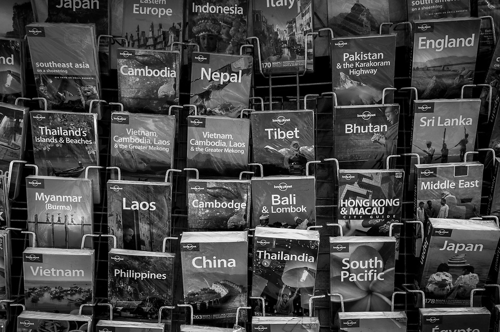 Lonely Planet destination guidebooks for sale on Khao San Road in Bangkok, Thailand. (November 19, 2011)