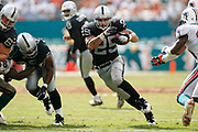 September 30, 2007 - Miami Gardens, FL<br /> <br /> Justin Fargas #25 of the Oakland Raiders rushes upfield during the Oakland Raiders 35-17 victory over the Miami Dolphins at Dolphin Stadium in Miami Gardens, Florida.<br /> <br /> JC Ridley/CSM