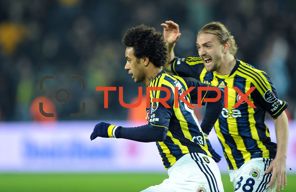 Fenerbahce's Cristian Oliveira Baroni (L) celebrate his goal during their Turkish superleague soccer match Fenerbahce between Gaziantepspor at the Sukru Saracaoglu stadium in Istanbul Turkey on Monday09 January 2011. Photo by TURKPIX