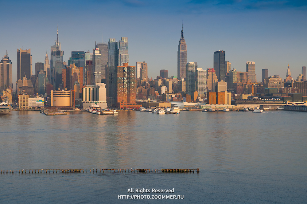 Empire state Building, skyscrapers and piers of the Huson river in the evening