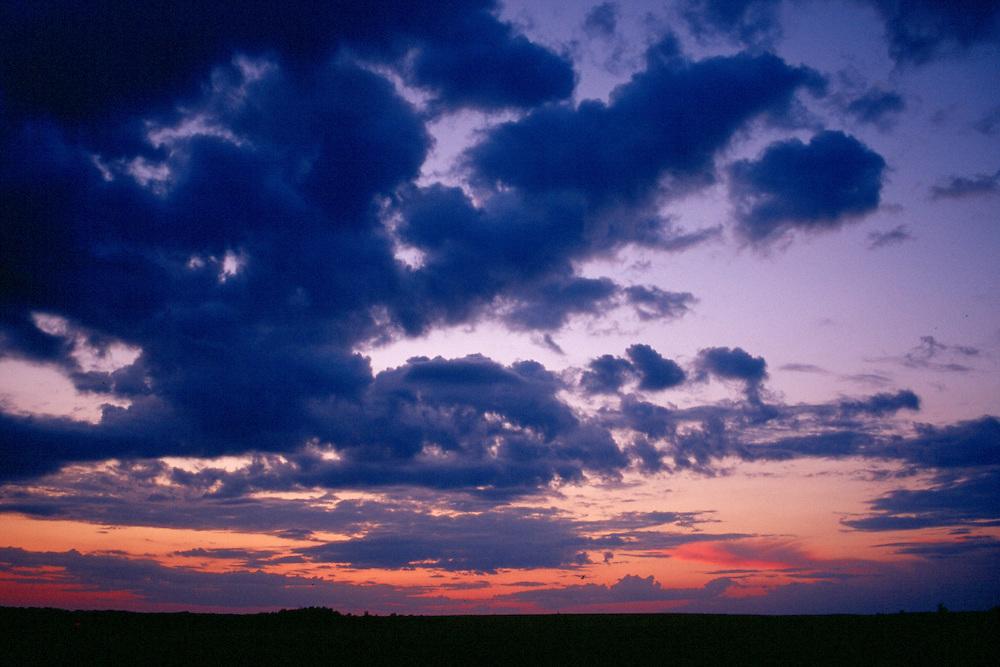 Big sky at dusk, filled with late evening colours, Saskatchewan plains