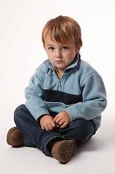 Young boy sitting crossed legged,
