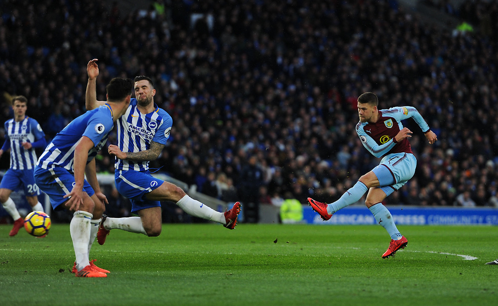 Burnley's Johann Gudmundsson's shot blocked by Brighton & Hove Albion's Shane Duffy<br /> <br /> Photographer Ashley Western/CameraSport<br /> <br /> The Premier League - Brighton and Hove Albion v Burnley - Saturday 16th December 2017 - The Amex Stadium - Brighton<br /> <br /> World Copyright © 2017 CameraSport. All rights reserved. 43 Linden Ave. Countesthorpe. Leicester. England. LE8 5PG - Tel: +44 (0) 116 277 4147 - admin@camerasport.com - www.camerasport.com