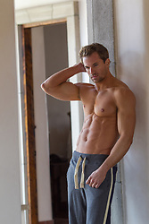 hot shirtless man at home in sweatpants