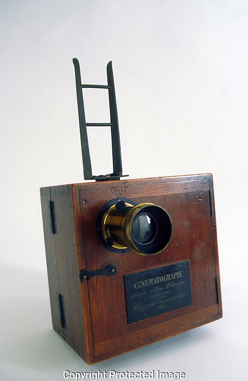 A 27 MG IMAGE OF:.. The Lumiere-cinematographe.  This was a combination of a camera and a projector.  This was the first practical camera that you could go out and make a movie and people did.  Short ten to fifteen second slips of  places and people around the world were made and collected.  Photo by Dennis Brack