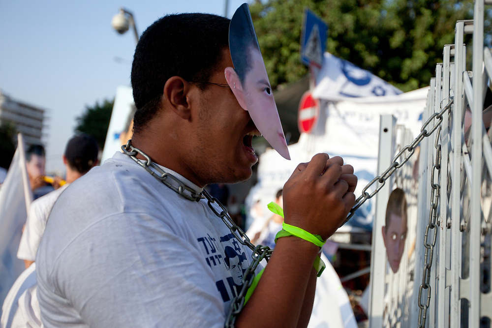 Supporters of Israeli captured soldier Gilad Shalit, calling for his release, demonstrate outside a protest tent near Prime Minister Netanyahu's residence in Jerusalem on August 4, 2010.