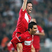 Turkey's Gokhan GONUL (L) celebrates his goal with teammate during their UEFA EURO 2012 Qualifying round Group A soccer match Turkey between Austria at Sukru Saracoglu stadium in Istanbul March 29, 2011. Photo by TURKPIX