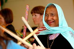 Muslim woman taking part in community dance event; Bradford; Yorkshire UK