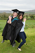 """18/04/2017 REPRO FREE:  <br /> MA Student Angel Cray and Post BAC graduate Charlotte Lavelle from Ballina  who graduated  at the 13th conferring ceremony, held in the Minstrels gallery the 16th century Newtown Castle at the heart of the BCA campus, exemplifies the continued success of the Burren's  alternative model of art education . <br /> The Irish and  international graduates included Elizabeth Matthews, conferred with  a PhD for her research on Utopian studies , and six international graduates whose work on display in the BCA gallery addressed the ultimate question, """"who am I called to be"""" In her address President of the college Mary Hawkes Greene referred to the unique place based educational  model  committed to  individual student centred  education accredited by NUIGalway , and how it effectively  embraces the often conflicting forces of the global and the local, the public and the private as well as the collective and the individual. <br /> .  Photo:Andrew Downes, xposure"""