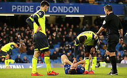 Chelsea's Marcos Alonso on the ground after picking up an injury