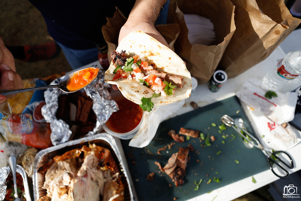 Turkey and steak fajitas are served in parking lot 4 before the Cowboys and Steelers game at Cowboys Stadium in Arlington, Texas, on December 16, 2012.  (Stan Olszewski/The Dallas Morning News)