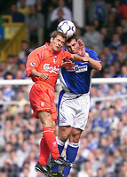 Liverpool's Michael Owen and Everton's David Unsworth challenge for the ball during the Merseyside Derby at Goodison Park.
