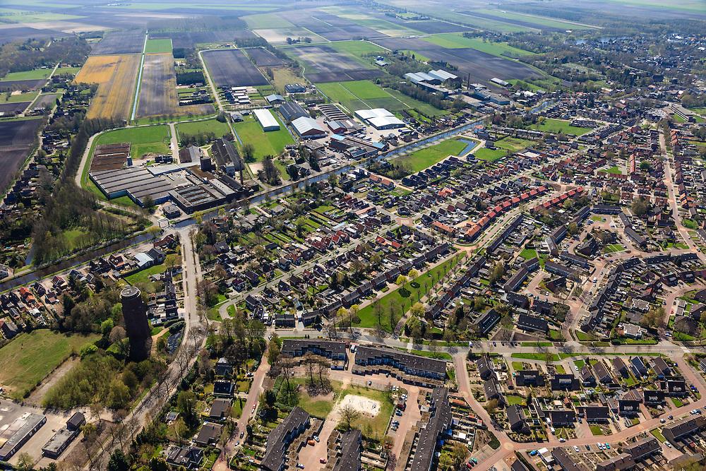 Nederland, Groningen, Gemeente Pekela,  01-05-2013; Oude Pekela, links watertoren aan de Winschoterweg en aan de andere kant van het Pekelderdiep de oude strokartonfabriek Aastroom (Aa-stroom).<br /> Small provincial town, known for the production of strawboard (northeast Holland).<br /> luchtfoto (toeslag op standard tarieven);<br /> aerial photo (additional fee required);<br /> copyright foto/photo Siebe Swart