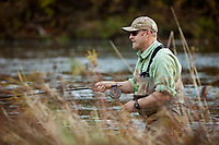Angler and guide, Drew Price searching for fish on the Dog River in central Vermont