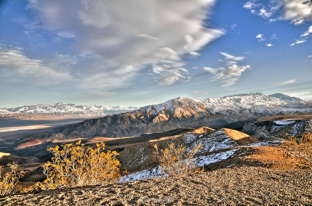 The Panamint Range and Panamint Valley are in the distance to the left, and the Argus Range is in the middle ground.  This image taken from near the Father Crowley Monument along CA Highway 190