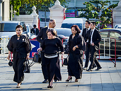 November 3, 2018 - Bangkok, Bangkok, Thailand - Friends and family of Vichai Srivaddhanaprabha walk into Wat Debsirin for the first day of Vichai's funeral rites. Vichai was the owner of King Power, a Thai duty free conglomerate, and the Leicester City Club, a British Premier League football (soccer) team. He died in a helicopter crash in the parking lot of the King Power stadium in Leicester after a match on October 27. Vichai was Thailand's 5th richest man. The funeral is expected to last one week. (Credit Image: © Sean Edison/ZUMA Wire)