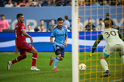 September 26, 2018 - Bronx, New York, US - New York City FC midfielder MAXIMILIANO MORALEZ (10) takes a shot on goal against Chicago Fire goalkeeper STEFAN CLEVELAND (30) during a regular season match at Yankee Stadium in Bronx, New York.  New York City FC defeats Chicago Fire 2 to 0 (Credit Image: © Mark Smith/ZUMA Wire)